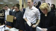 Russian opposition leader Alexei Navalny, second right, stands while listening to a judge in a courtroom during a trial in Kirov, Russia, on Wednesday, April 17. (MITYA ALESHKOVSKIY/AP)