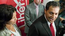 Dr. Raj Sherman, right, speaks to reporters after winning the Alberta Liberal Party leadership in Edmonton, Alberta, on Sept. 10, 2011. (John Ulan/THE CANADIAN PRESS)