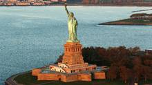 The idea that American democracy could be a beacon to the world has endured since the Statue of Liberty was dedicated by President Grover Cleveland on Oct. 28, 1886. (LUCAS JACKSON/REUTERS)
