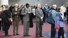 Job seekers stand in line during a Career Expo job fair in Portland, Ore. (Rick Bowmer/AP)