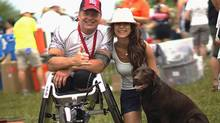 Rich Vanderwal and wife Carole Chebaro are shown after completing an Ironman half-triathlon, in Welland, Ont., in this 2012 family photo. Vanderwal is paraplegic and he met wife after his accident. (THE CANADIAN PRESS)