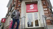 A man walks past a Scotiabank branch on Dundas Street West in Toronto in this file photo. (Darren Calabrese For The Globe and Mail)