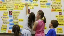 Students get french words off the board in the Grade 2 class of Natalie Ruel at Mother Teresa elementary school in Calgary, Alberta, June 21, 2012. (TODD KOROL/Todd Korol)