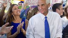 Charlie Crist (R) waits alongside Florida first lady Carole Crist before announcing that he will run as an independent for U.S. Senate during a news conference in St. Petersburg, Florida April 29, 2010. (SCOTT AUDETTE/REUTERS)