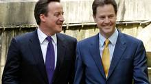 Prime Minister David Cameron and Deputy Prime Minister Nick Clegg arrive for their first joint press conference in the Downing Street garden on May 12, 2010, in London. (Christopher Furlong/Getty Images)