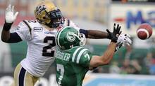 Winnipeg Blue Bombers Jovon Johnson (2) breaks up a pass intended for Saskatchewan Roughriders Weston Dressler (7) during the second half of Canadian Football League action in Regina September 5, 2010. (FRED GREENSLADE/Reuters)