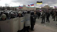 Ukrainian riot police block pro-Russia supporters near the regional administrative building during a rally at a central square in Kharkiv, Ukraine, on March 16, 2014. (Sergei Chuzavkov/The Associated Press)