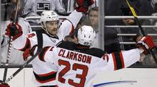 New Jersey Devils' Adam Henrique (L) celebrates with teammate David Clarkson during Game 4 of the Stanley Cup final in Los Angeles, June 6, 2012. (ALEX GALLARDO/REUTERS)