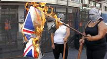 Left-wing activists burn an Union Jack flag in front of the Argentine -British Chamber of Commerce in Buenos Aires March 2, 2012. Argentine Industry Minister Debora Giorgi called on firms to stop importing UK goods in protest at Britain's position on the Falkland Islands. (ENRIQUE MARCARIAN/REUTERS/ENRIQUE MARCARIAN/REUTERS)