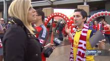 Shauna Hunt interviews a Toronto FC soccer fan in Toronto on Sunday, May 10, 2015, in this video frame grab. A Toronto reporter is setting social media abuzz by fighting back against a controversial trend that sees men hurling obscenities at female journalists on the job. Shauna Hunt of CityNews was the latest woman to be heckled by a group of men shouting sexually explicit comments into her microphone as she tried to cover a local soccer game. (HO/CITY NEWS/THE CANADIAN PRESS)