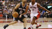 San Antonio Spurs guard Tony Parker (9) dribbles the ball past Toronto Raptors guard Kyle Lowry (7) during the first half at the Air Canada Centre. (John E. Sokolowski/USA Today Sports)