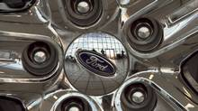 The Ford logo is displayed on a car wheel at a dealership in Omaha, Neb. (Nati Harnik/AP)