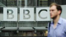 A pedestrian walks past a BBC logo at Broadcasting House in central London October 22, 2012. (Olivia Harris/Reuters)