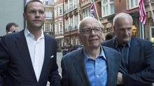 James Murdoch and his father Rupert leave the Stafford Hotel in central London in this July 10, 2011 file photo. (OLIVIA HARRIS/Reuters)