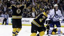 Boston Bruins left wing Milan Lucic, left, celebrates a goal scored by center David Krejci (46) as Toronto Maple Leafs left wing Nikolai Kulemin (41) looks on during the second period in Game 1 of a first-round NHL hockey playoff series in Boston, Wednesday, May 1, 2013. (Elise Amendola/AP)