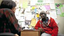 Tavoy Williams, an 18-year-old student who is in Grade 12 at Forest Lawn High School in Calgary, talks to the wellness-centre guidance counsellor Tina Merali. (Chris Bolin/CHRIS BOLIN FOR THE GLOBE AND MAIL)