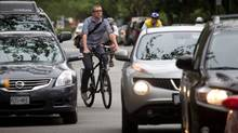 Chris Bruntlett rides his bike on the 7th Avenue bikeway without a helmet while on his way home after work in Vancouver, B.C., on Thursday June 21, 2012. (DARRYL DYCK FOR THE GLOBE AND MAIL)