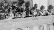 Students in a classroom at the Fort Resolution Indian Residential School in Fort Resolution, NWT. (Reuters/Library and Archives Canada)