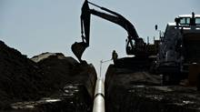 Enbridge Inc. said it found a way to ship more Alberta oil to the U.S. that doesn't require a review similar to the one faced by Keystone XL. (DANIEL ACKER/BLOOMBERG)