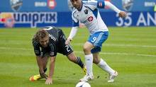 Montreal Impact's Marco Di Vaio (9) breaks away from Sporting Kansas City's Michael Harrington (2) during first half MLS action in Montreal, Saturday, September 22, 2012. (Graham Hughes/THE CANADIAN PRESS)