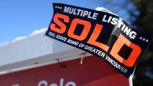 A real estate sold sign is shown outside a house in Vancouver, Tuesday, Jan.3, 2017. (Jonathan Hayward/THE CANADIAN PRESS)