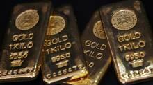 Gold bars are displayed at bullion house in Mumbai. (ARKO DATTA/REUTERS)