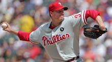 Starting pitcher Roy Halladay #34 of the Philadelphia Phillies delivers against the Colorado Rockies at Coors Field on August 3, 2011 in Denver, Colorado. (Doug Pensinger/Getty Images)