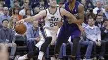 Utah Jazz's Gordon Hayward drives around Phoenix Suns' Marcus Morris (Rick Bowmer/AP)