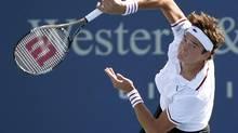 Milos Raonic of Canada serves to Stanislas Wawrinka of Switzerland in their quarter final round match in the Cincinnati Open tennis tournament in Cincinnati, Ohio, August 17, 2012. (JOHN SOMMERS II/REUTERS)