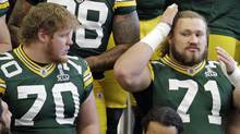 Members of the Green Bay Packers prepare for their team photo on Feb. 4, 2011, in Dallas, whre they will face the Pittsburgh Steelers in the NFL football Super Bowl. (Eric Gay/AP)