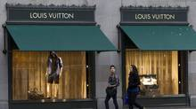 Pedestrians walk past a Louis Vuitton store in downtown Vancouver, Tuesday, March 8, 2011. (Jonathan Hayward/ The Canadian Press/Jonathan Hayward/ The Canadian Press)