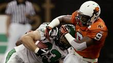 BC Lions safety Baron Miles, right, is knocked off his feet while trying to stop Saskatchewan Roughriders' Chris Szarka. (ANDY CLARK)