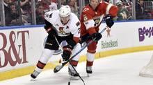 Florida Panthers centre Derek MacKenzie defends against Ottawa Senators defenceman Dion Phaneuf on Feb. 26, 2017. (Steve Mitchell/USA Today Sports)