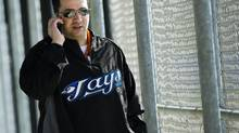 Toronto Blue Jays Senior Vice President of Baseball Operations and General Manager Alex Anthopoulos talks on his cell phone during baseball spring training in Dunedin, FL, on Wednesday, Feb. 16, 2011. (Nathan Denette/THE CANADIAN PRESS)