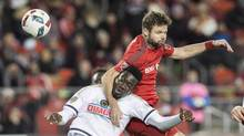 Toronto FC's Drew Moor battles for the ball with Philadelphia Union's C.J. Sapong in Toronto, Wednesday October 26, 2016. (Mark Blinch/THE CANADIAN PRESS)
