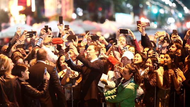 Benedict Cumberbatch takes a selfie in front of fans as he arrives on the red carpet for the film The Current War at the Toronto International Film Festival, in Toronto on Sept. 9, 2017.