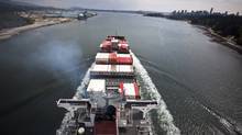 A cargo ship loaded with cargo containers bound for the Vancouver port makes its way under the Lions Gate bridge April 29, 2009. (JOHN LEHMANN/JOHN LEHMANN/GLOBE AND MAIL)