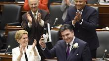 Ontario Finance Minister Charles Sousa, right, delivers the 2017 Ontario budget next to Premier Kathleen Wynne at Queen's Park in Toronto on Thursday, April 27, 2017. (Nathan Denette/THE CANADIAN PRESS)