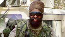 Defence Minister Harjit Sajjan is shown during one of his tours in Afghanistan.