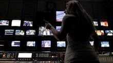 An employee of the Greece state broadcaster ERT gives instructions in front of monitors in the control room at the television station's headquarters in Athens, on Tuesday, June 18, 2013. State TV channels in Greece remained off-air Tuesday as the political storm over the future of public broadcaster ERT rages on despite a court ruling that the prime minister's decision to pull the plug was wrong. Fired ERT workers have continued live broadcasts streamed online and satellite, helped by the Geneva, Switzerland-based European Broadcasting Union, which represents the continent's public broadcasters. (Petros Giannakouris/AP)
