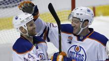 Edmonton Oilers defenceman Eric Gryba celebrates with right wing Zack Kassian after scoring a goal against the Florida Panthers during the second period. (Lynne Sladky/AP)