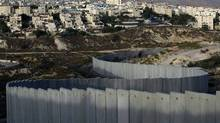 The east Jerusalem Jewish settlement of Pisgat Zeev is seen behind a section of Israel's controversial separation barrier in east Jerusalem. (Ahmad Gharabli/AFP/Getty Images/Ahmad Gharabli/AFP/Getty Images)
