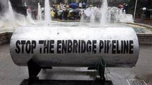A giant piece of pipeline is shown in front of the Vancouver Art Gallery on Aug. 31, 2010. The pipeline was brought there by opponents of the Northern Gateway pipeline project. (Jonathan Hayward/The Canadian Press)