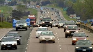 Another long weekend ,another long , slow drive up to the cottage for these drivers as they head north on Hwy 400 near the 4th Line.