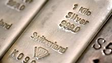 The hallmark details on one kilogram silver bars are seen at London bullion dealers Gold Investments Ltd. in this arranged photograph in London, U.K., on Thursday, April 4, 2013. (Simon Dawson/Bloomberg)