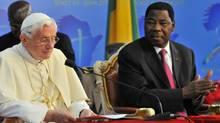 Pope Benedict XVI prepares speaks next to Benin's President Thomas Yayi Boni (R) at the Presidential Palace in Cotonou on Nov. 19, 2011. (Issouf Sanogo/AFP/Getty Images/Issouf Sanogo/AFP/Getty Images)