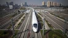 A high-speed train leaves the Beijing South Station bound for for Shanghai in June, 2011. China has a network of more than 11,000 kilometres of fast track. (Alexander F. Yuan/AP)