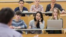 Attentive class in a lecture hall (Wavebreakmedia Ltd/Getty Images/Wavebreak Media)