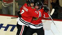 Brent Seabrook #7 of the Chicago Blackhawks hugs teammate Patrick Kane #88 after Kane scored his second goal of the game against the St. Louis Blues at the United Center on November 30, 2010 in Chicago, Illinois. The Blackhawks defeated the Blues 7-5. (Jonathan Daniel/2010 Getty Images)