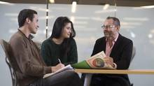 McGill professor Steve Maguire, right, speaks with undergraduate students in the program, Juan Ubaque, left, and Leilanie Lee. (Christinne Muschi/The Globe and Mail)